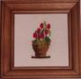 Květináč s červenými kvítky